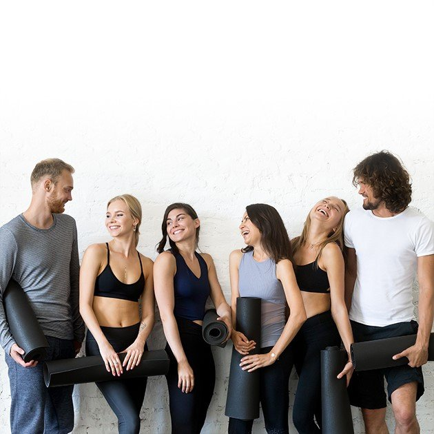 Group of people with VibroSlim yoga mat